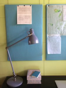 bulletin boards, lamp and desk